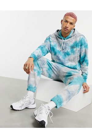 ASOS Co-ord oversized joggers in tie dye effect with San Francisco embroidery-Multi