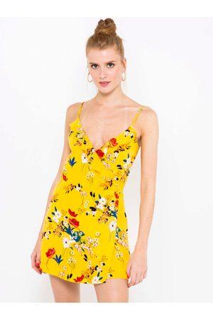 Camaïeu Žlutý květovaný krátký overal