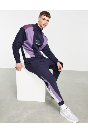 ASOS Co-ord tapered joggers with colour block diagonal side panels in navy & purples-Black