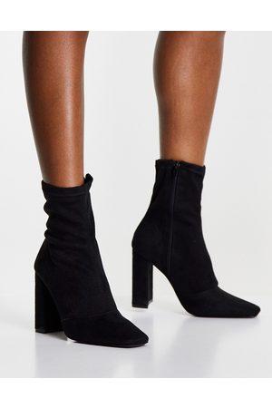 ASOS Effect block heel sock boots in black