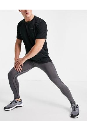 Nike Nike Pro Training Dri-FIT baselayer tights in grey