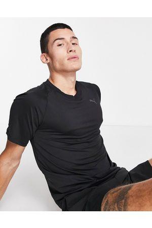 PUMA Muži Trička - Yoga Studio t-shirt in black