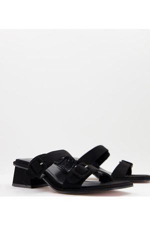 ASOS DESIGN Wide Fit Willow buckle detail heeled mules in black