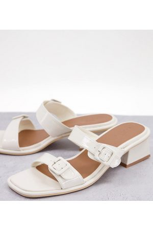 ASOS DESIGN Wide Fit Willow buckle detail heeled mules in white patent