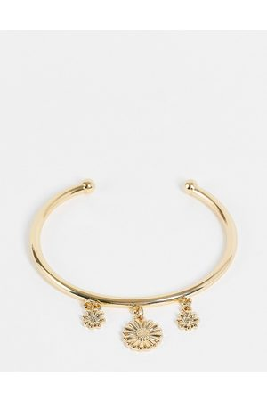 ASOS DESIGN Bangle bracelet with daisy charms in gold tone