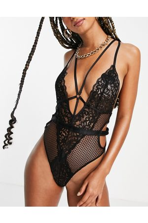 Ann Summers Obsession lace and fishnet plunge front bodysuit with strapping detail in black