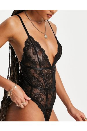 Lost Ink Lace strappy back bodysuit with satin boning in black