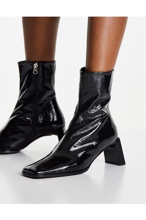 ASOS DESIGN Rosa premium leather heeled ankle boots in black