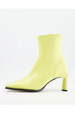 ASOS Remedy premium leather square toe heeled boots in lemon yellow