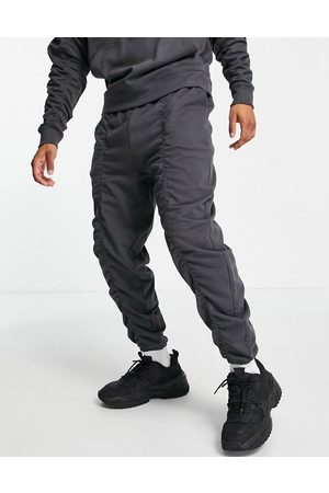 ASOS DESIGN Organic co-ord oversized joggers with ruching details in washed black