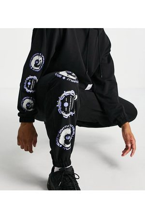ASOS Co-ord oversized joggers with woven tab and graphic print in black