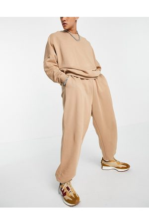ASOS Muži Tepláky - Co-ord oversized joggers with toggle details in light brown