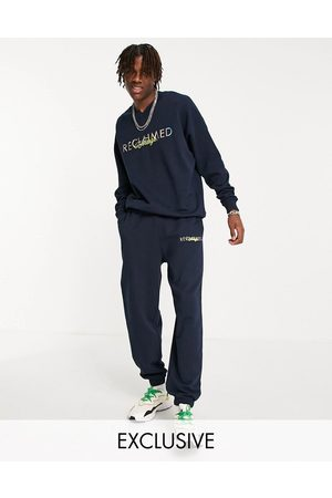 Reclaimed Inspired 90s joggers with logo embroidery-Navy