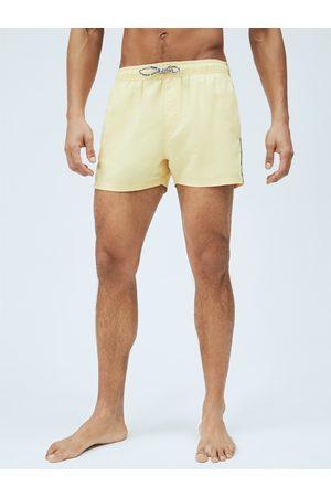 Pepe Jeans Muži Šortky - Pánské žluté plavky Brian
