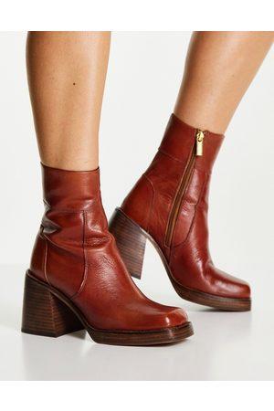 ASOS DESIGN Region leather mid-heel boots in tan-Brown