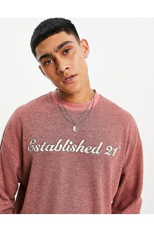 ASOS Oversized long sleeve t-shirt in red brushed marl with text print