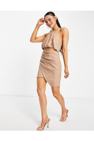 ASOS DESIGN Halter mini dress with drape detail skirt and cut out detail in mocha-Brown