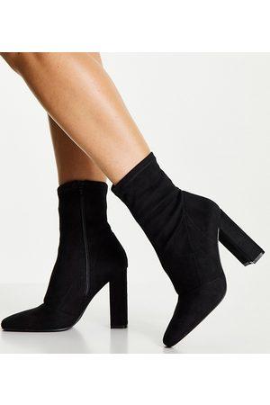 ASOS DESIGN Wide Fit Effect block heel sock boots in black