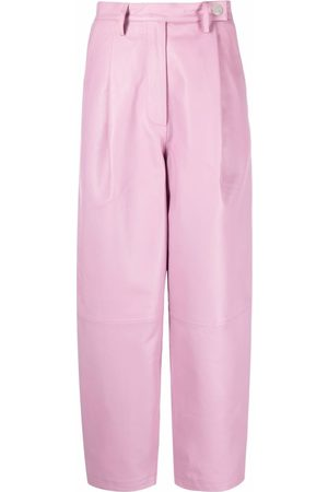 REMAIN Pleat-detail leather high-waisted trousers