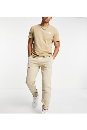 The North Face Zumu joggers in beige Exclusive at ASOS-Brown