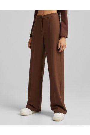 Bershka Wide leg slouchy dad tailored trousers in brown