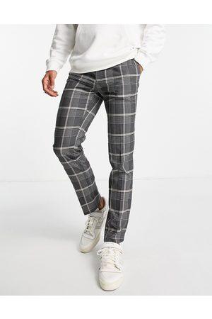 River Island Muži Chino - Skinny check trousers in black and ecru
