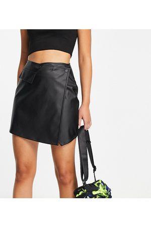COLLUSION Asymmetric pu mini skirt in black