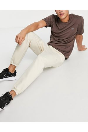 ASOS Muži Kalhoty - Icon training jogger with tapered fit in stone-Neutral