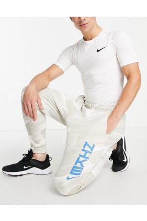 Nike Sport Clash printed joggers in stone-Neutral