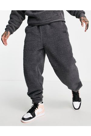 ASOS Co-ord oversized joggers in teddy borg with badge-Grey