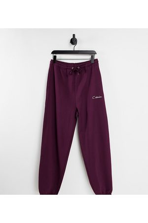 COLLUSION Unisex oversized varsity joggers in vintage burgundy co-ord-Red