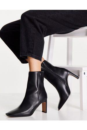 ASOS Remmy set-back heeled boots in black