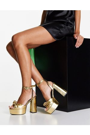 ASOS Note knotted platform heeled sandals in gold