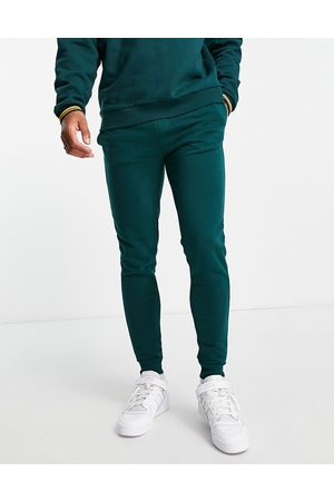 River Island RI muscle fit joggers in green