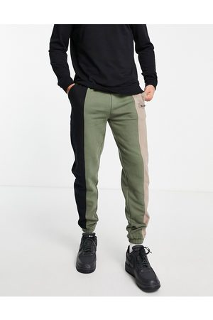Good For Nothing Muži Tepláky - Spliced joggers in black and khaki with mixed logo print-Multi