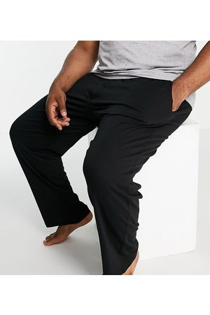 French Connection Muži Chino - Plus FCUK jersey trousers in black