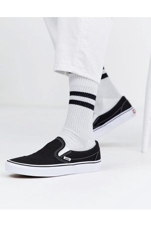 Vans Classic Slip-On trainers in black and white