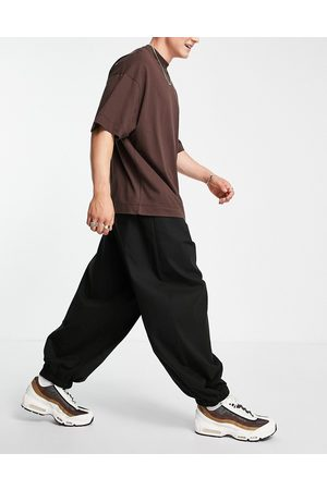 ASOS Extreme oversized chinos with elasticated waist in black