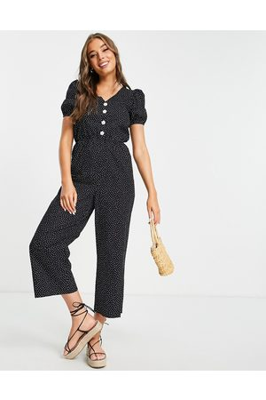 Monki Ženy Overaly dlouhé - Peg jumpsuit with puff sleeves in black spot print