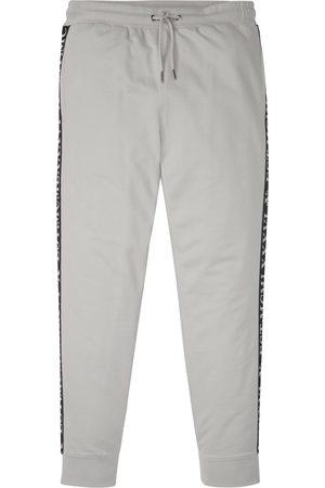 bonprix Sportovní kalhoty s potištěnými pruhy po stranách