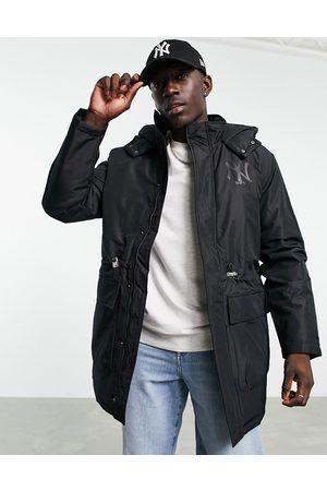 New Era Muži Péřové bundy - New York Yankees padded jacket in black