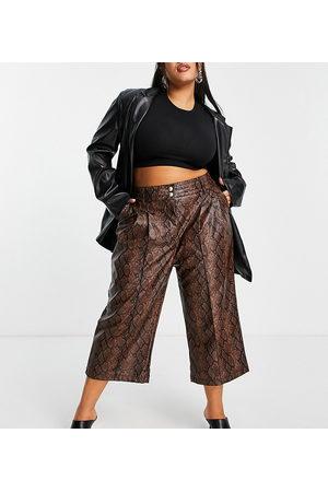 River Island Ženy Kožené kalhoty - Faux leather snakeprint straight leg trousers in brown