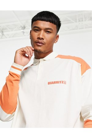 ASOS Oversized long sleeve polo t-shirt in colour block & text print-Multi