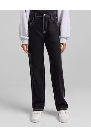 Bershka Ženy Široké nohavice - Contrast seam wide leg cargo jean in black