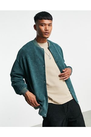 ASOS Oversized jersey bomber jacket in green acid wash