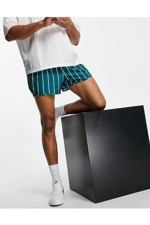 Weekday Stripe swim shorts in turquoise-Blue