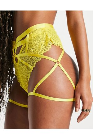 We Are We Wear Lace suspender leg harness in yellow