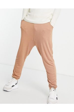 ASOS Lightweight viscose drop crotch joggers in washed brown-Grey