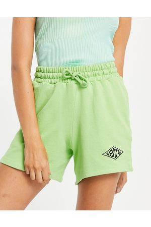 Topshop Co-ord jogger short with 1974 graphic in green