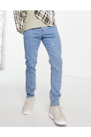 ASOS Skinny jeans in 'less thirsty' light wash with abrasions-Blue